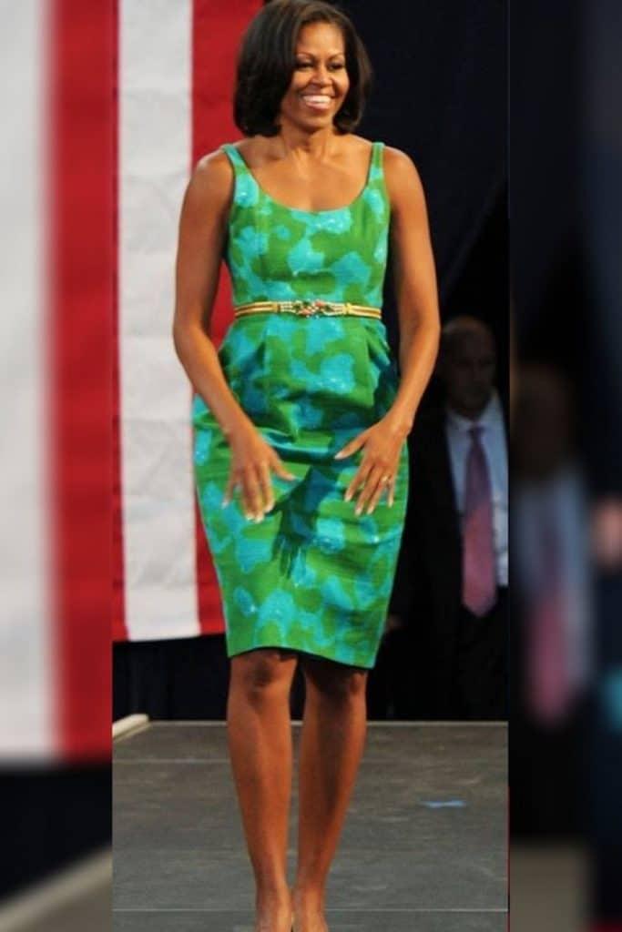 Michelle Obama wearing a green dress.