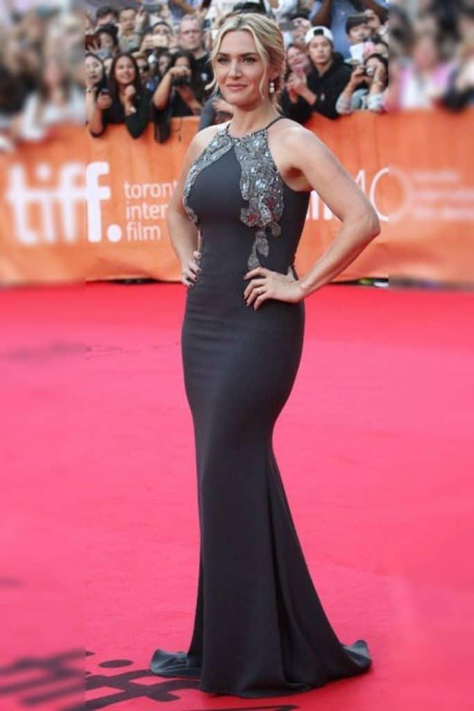 Kate Winslet wearing a silver dress.