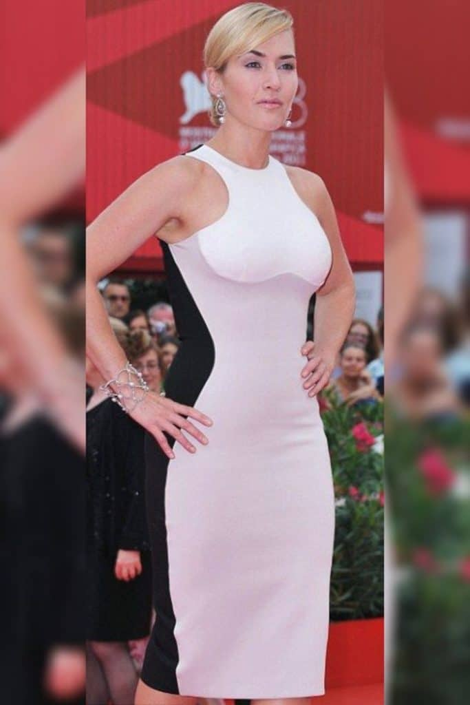 Kate Winslet wearing a white and black dress.