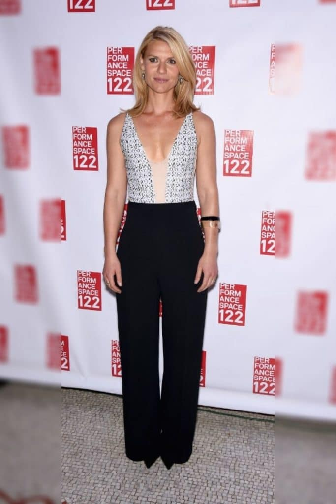 Claire Danes wearing a patterned top and black pants.