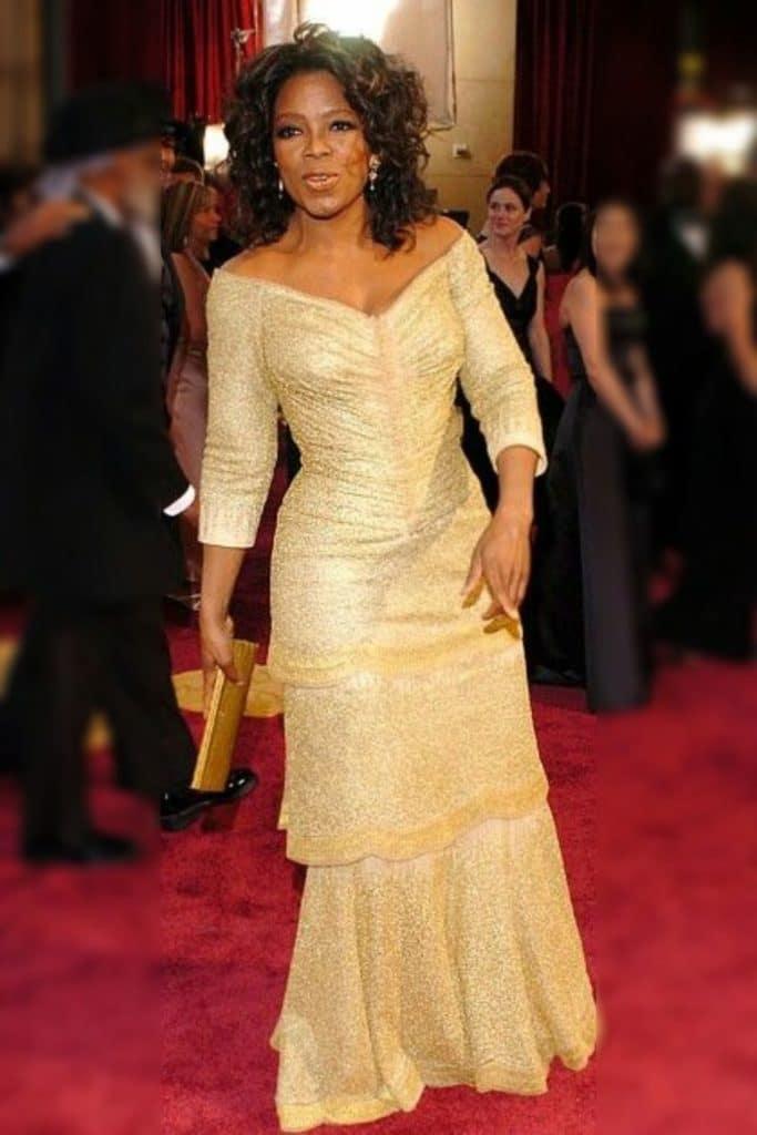 Oprah Winfrey wearing a gold dress.