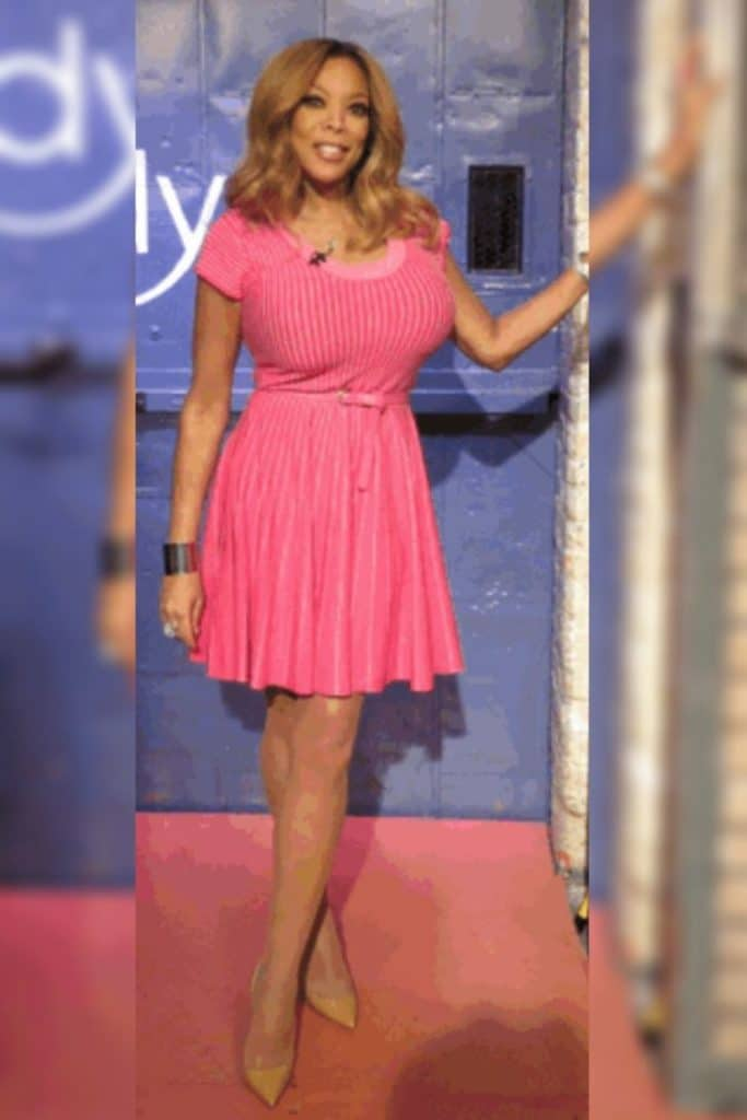 Wendy Williams wearing a pink dress.