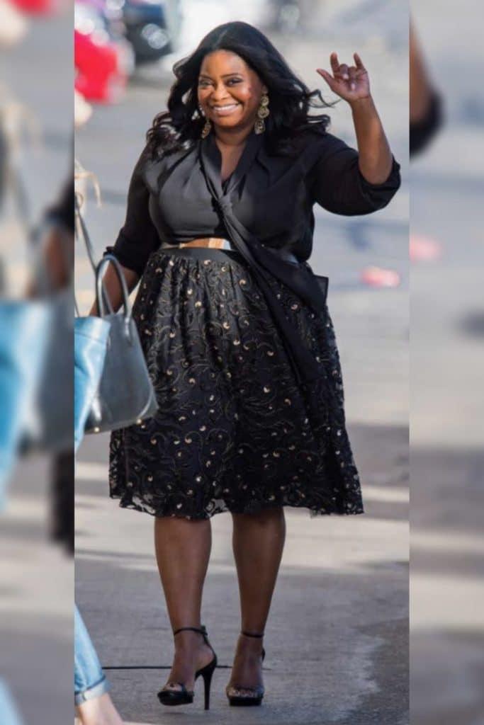 Octavia Spencer wearing a black dress.