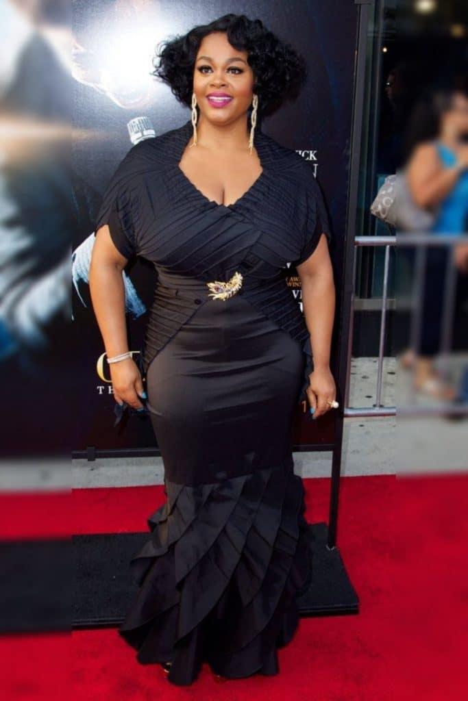 Jill Scott wearing a black dress.