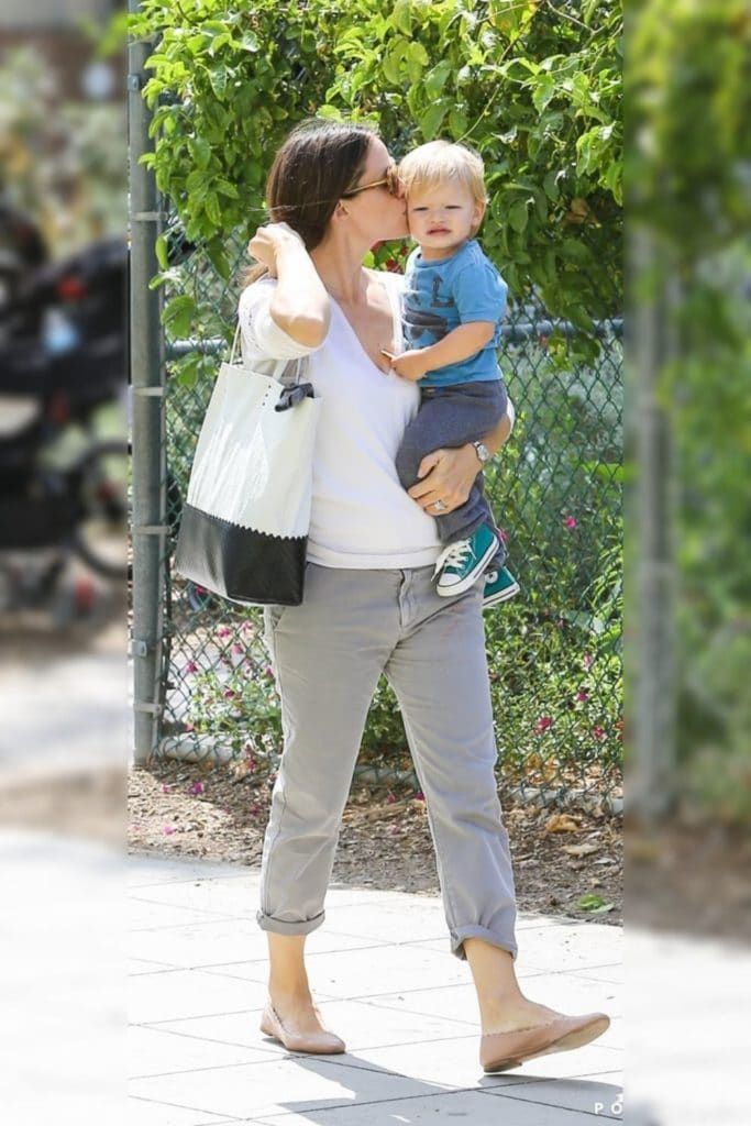 Jennifer Garner wearing a white top and grey pants.