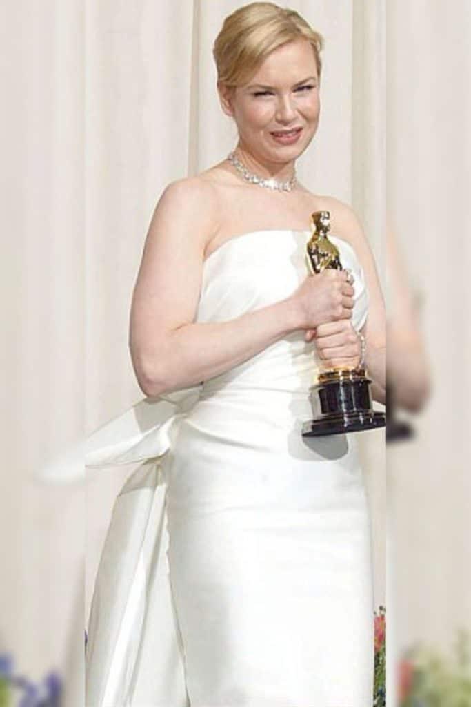 Renee Zellweger wearing a white dress.