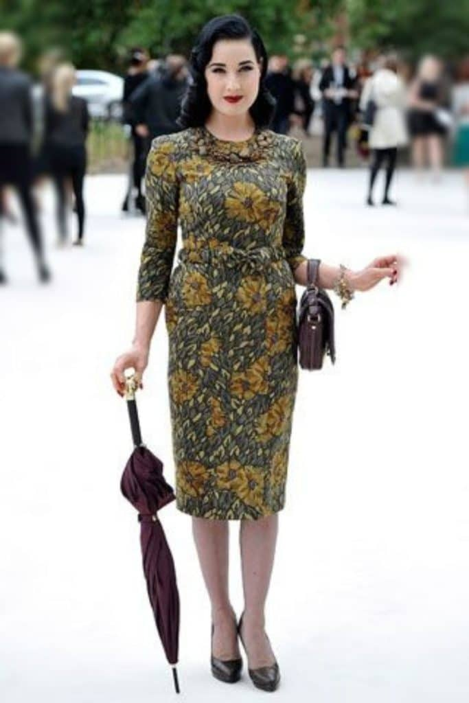 Dita Von Teese wearing a floral patterned dress.