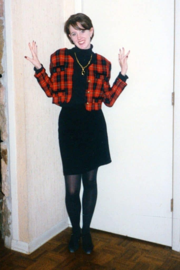 April from Stunning Style wearing a black turtleneck sweater, black skirt and patterned jacket.