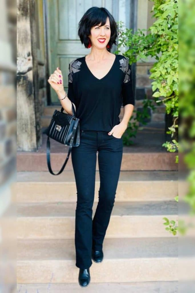 April from Stunning Style wearing a black top with black jeans.