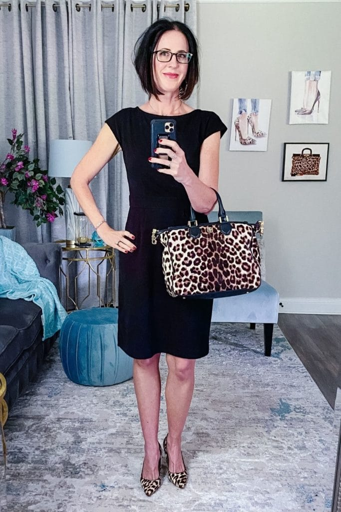 April from Stunning Style wearing a light summer dress with close toed heels and a matching bag.