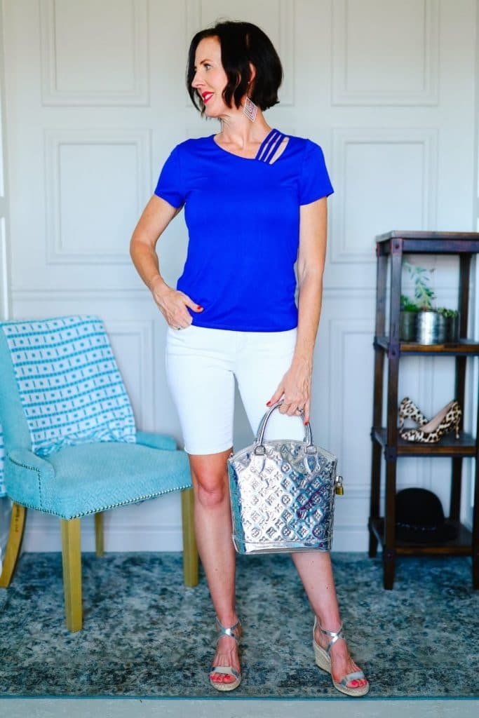 April from Stunning Style wearing white shorts and a blue tee as part of her summer capsule wardrobe.