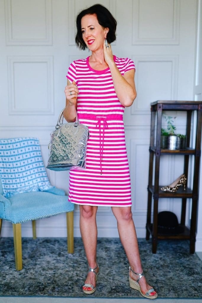 April from Stunning Style wearing a pink and white striped dress as part of her summer capsule wardrobe.