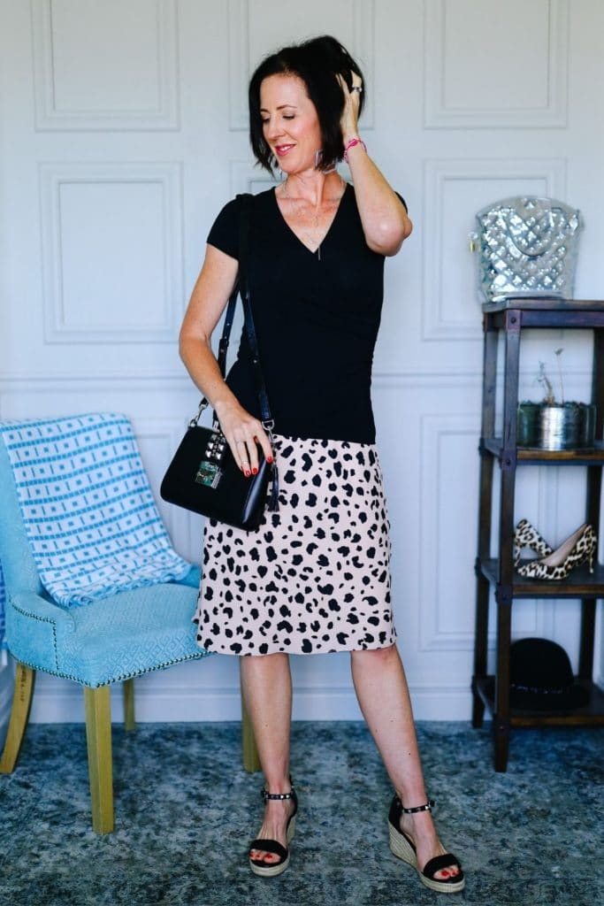 April from Stunning Style wearing a neutral leopard skirt with a black tee.