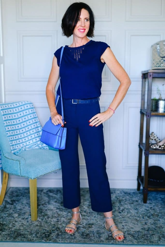 April from Stunning Style wearing blue cropped pants and a blue tee as part of her summer capsule wardrobe.