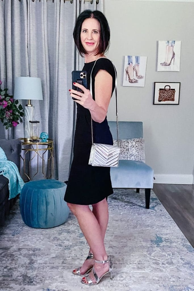 April from Stunning Style wearing a light summer dress with black with silver heels and a matching silver bag.
