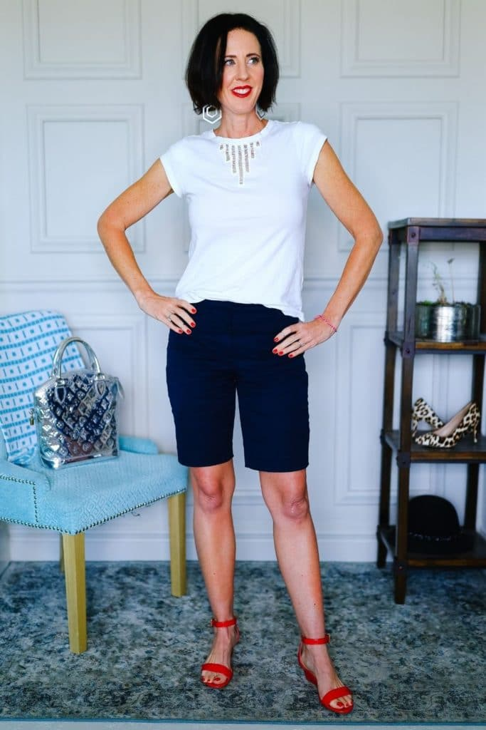 April from Stunning Style wearing black shorts and a neutral white tee as part of her summer capsule wardrobe.