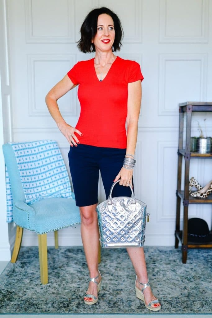April from Stunning Style wearing black shorts and a red colored top with silver bag.
