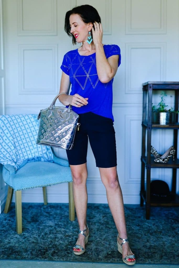April from Stunning Style wearing black shorts and a cobalt patterned top.
