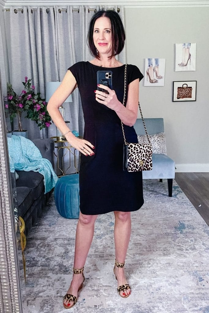 April from Stunning Style wearing a black dress with leopard heels and a matching bag.