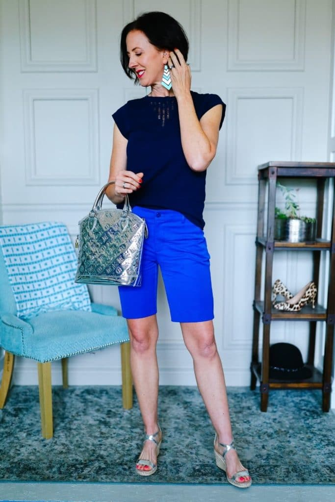 April from Stunning Style wearing a navy top with cobalt Bermuda shorts.