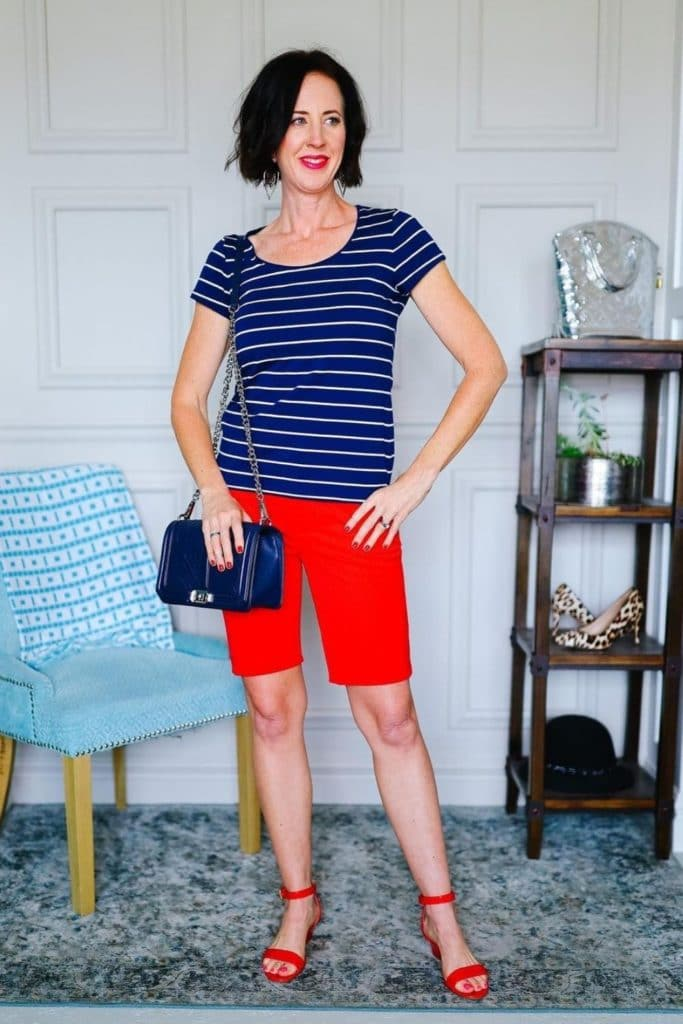 April from Stunning Style wearing a navy striped top with red Bermuda shorts.
