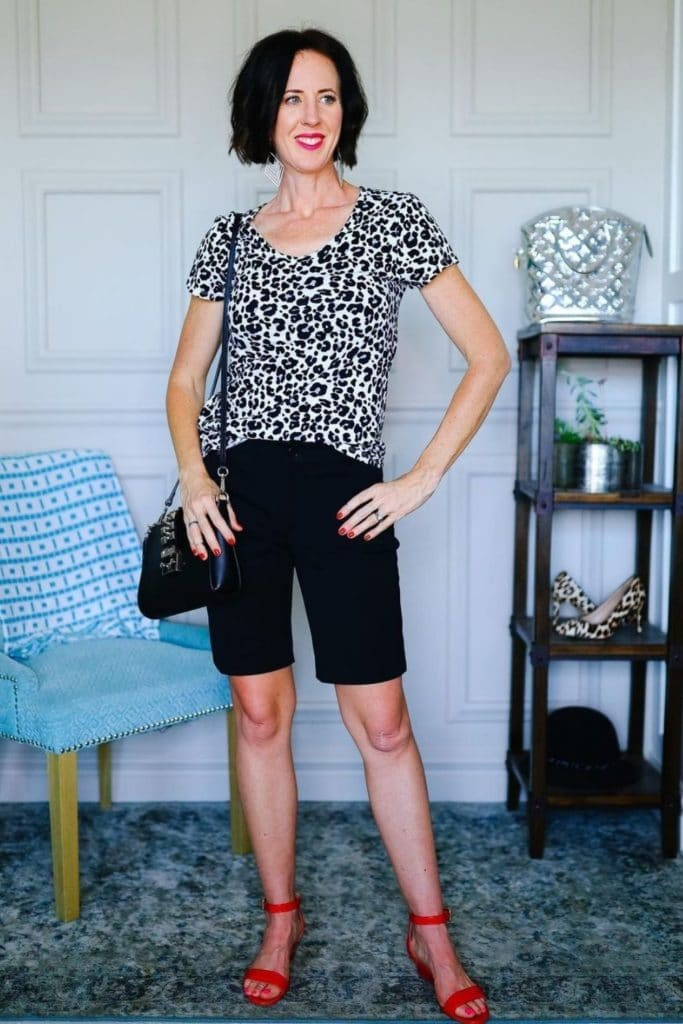 April from Stunning Style wearing a leopard patterned top with black Bermuda shorts.