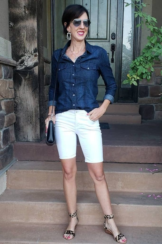 April from Stunning Style wearing a denim top with white Bermuda shorts.