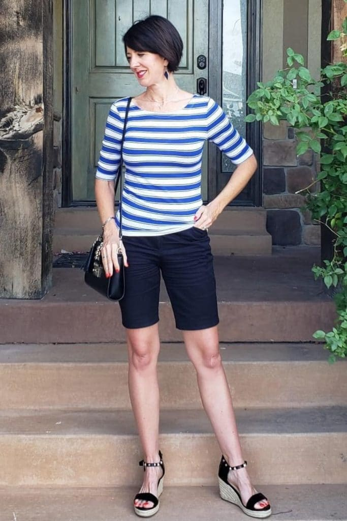 April from Stunning Style wearing a striped top with dark Bermuda shorts.
