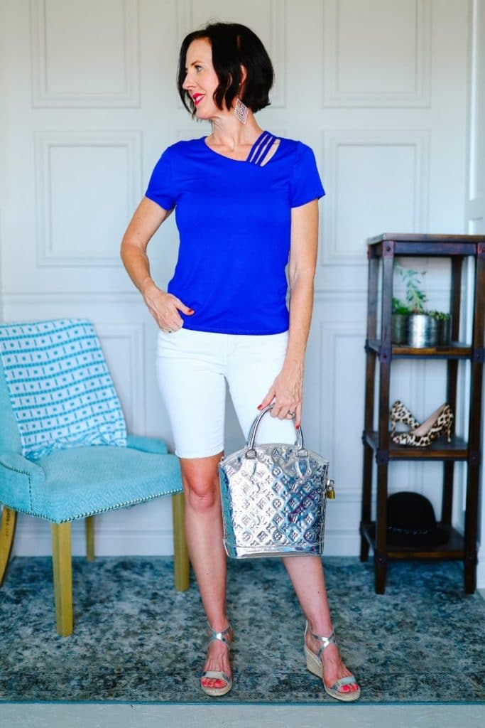 April from Stunning Style wearing a cobalt blue top with white Bermuda shorts.