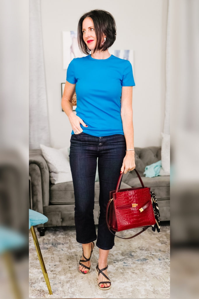 April from Stunning Style wearing a cyan top with red bag.