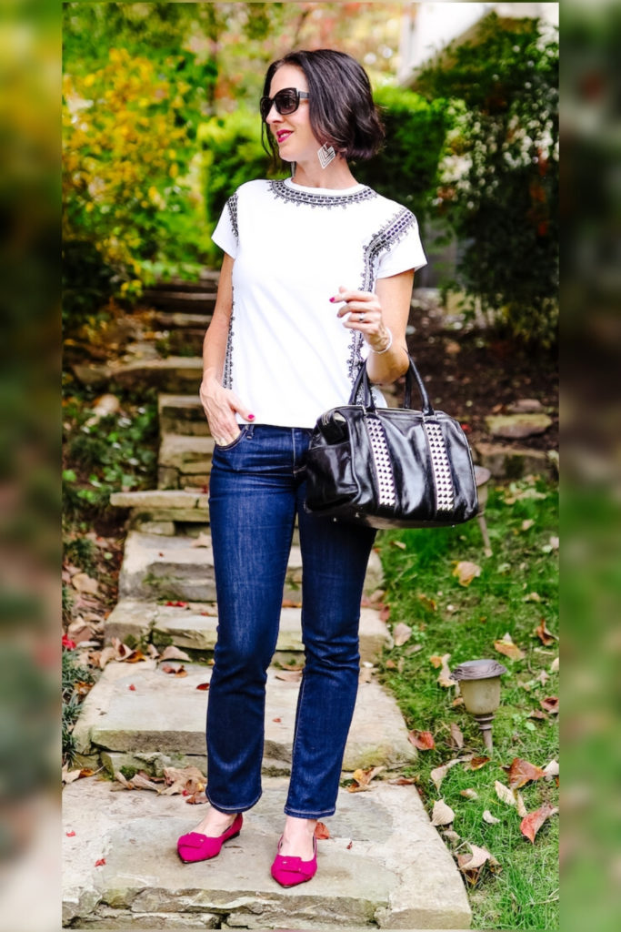 April from Stunning Style wearing a white top with burgundy flats to transition your outfits to fall.