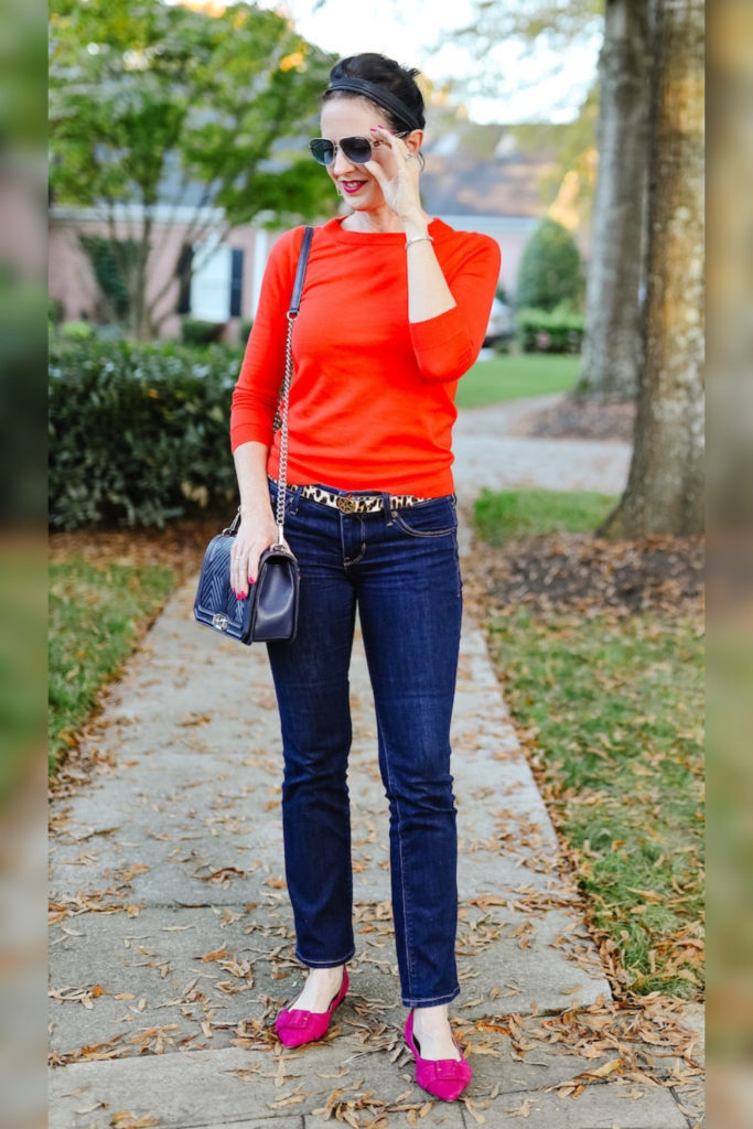 April from Stunning Style wearing an orange top with burgundy flats.