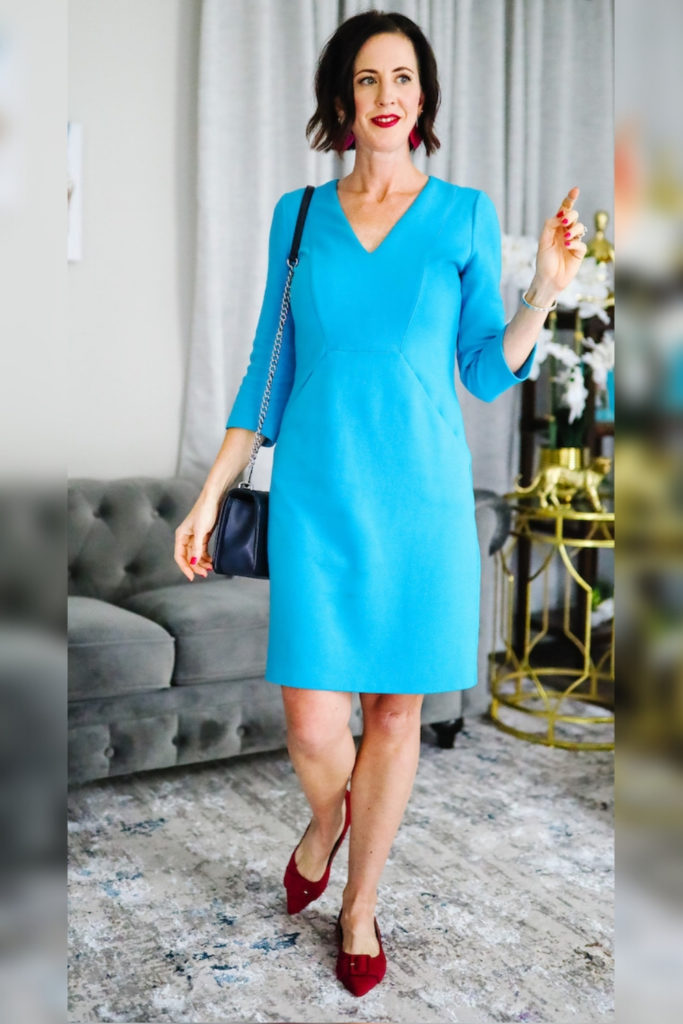 April from Stunning Style wearing a cyan dress with burgundy flats to transition your outfits to fall.